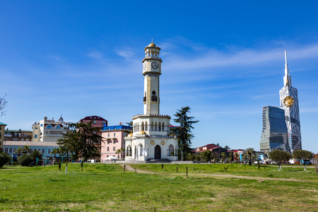 BATUMI, GEORGIA - MARCH 17, 2018: A tower in the style of the Ottoman Empire with a clock and a yellow dome. Also known as the Tower of Chacha