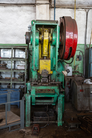 Retro industrial machine for metalworking in the factory workshop
