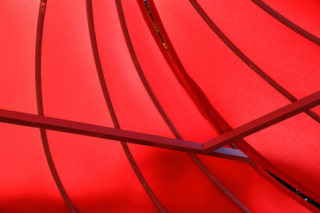 Abstract installation of metal beams and bright satin red fabric Stock Photo