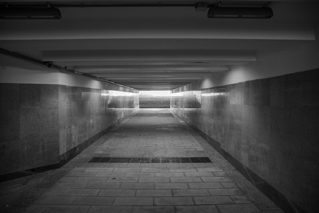 The underground passage lined with gray granite and marble Reklamní fotografie