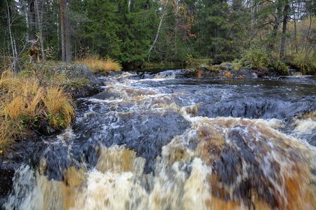 Scenic Karelian waterfall Ahvenkoski in autumn. Russia