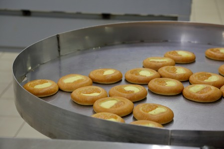Freshly baked confection in bread and sweets factory
