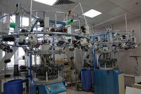 Automatic line for sewing clothes from synthetic and knitted fabrics