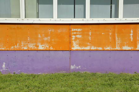 Textured surface of a bright building wall Stockfoto