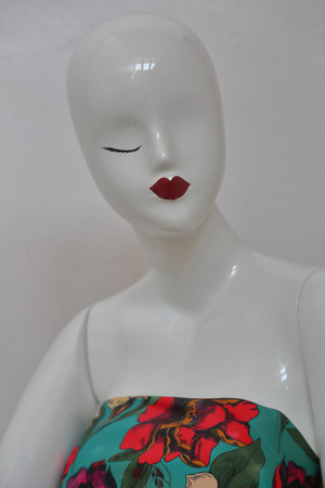 White one-eyed female mannequin of shiny plastic without hair