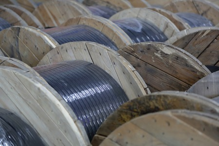 Massive wooden bobbins with wound electric cable