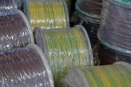 Massive plastic bobbins with wound electric cable Imagens