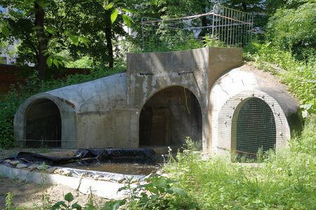 Unfinished bomb shelter made of durable concrete in a city block