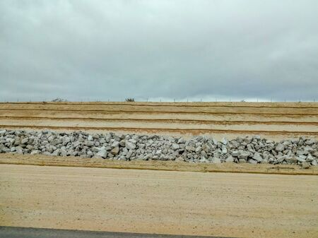 Multi-layer natural quarry for sand mining in cloudy weather