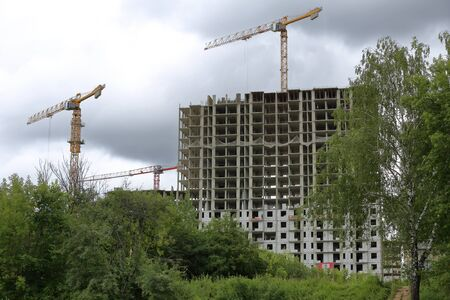 Large industrial construction crane at a construction site of houses
