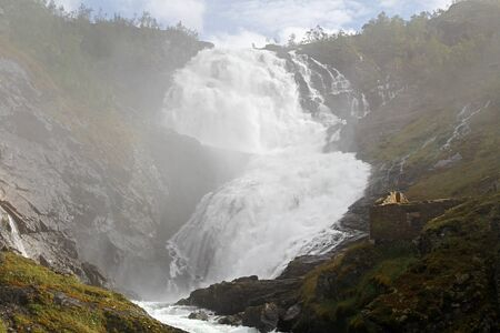 The grand waterfall of Kjosfossen in summer daytime. One of the largest in Norway