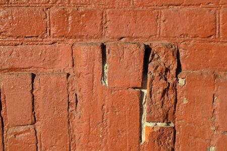 Embossed textured surface of the old orange brick and cement wall