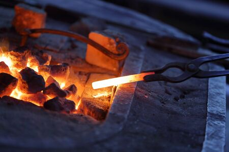 Hot coals in a furnace for heating metal for manual forging in a blacksmith workshop