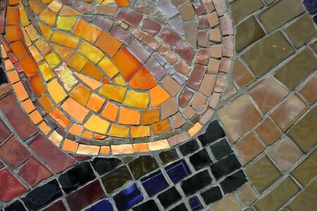 Mosaic pattern of multicolored tiles on the wall