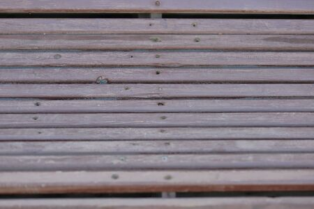 Textured surface of wooden boards with screws