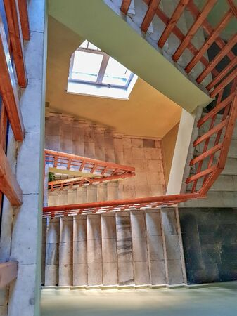 Old stone staircase with a handrail in a building without an elevator Reklamní fotografie