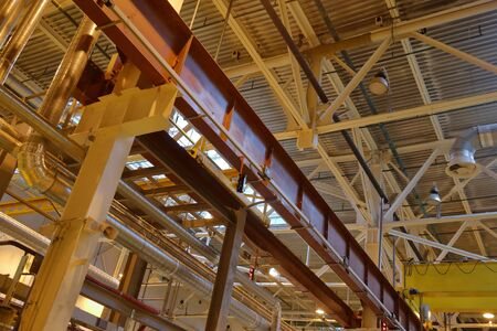 The combination of the steel beams and metal pipes in the industrial premise of the plant