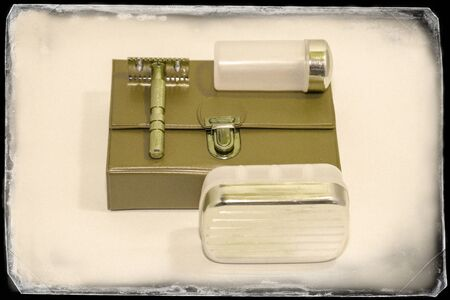 Vintage travel shaving kit in gold and brown on a white background Stockfoto