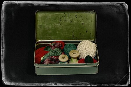 Vintage set of threads for sewing and crafts in an old metal box