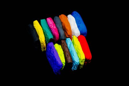 Bright multi-colored pieces of plasticine for creativity and development of skills since childhood
