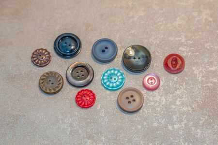 Old retro buttons for vintage clothes, creative and sewing on a light background Stockfoto