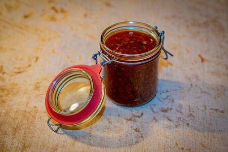 Appetizing homemade sweet sugar jam with sea buckthorn berries