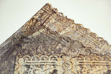 Beautiful textured surface of hand-woven retro lace for garment decoration. The beginning of the 20th century 版權商用圖片