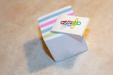 Multi-colored blocks of note sheets for office and home use