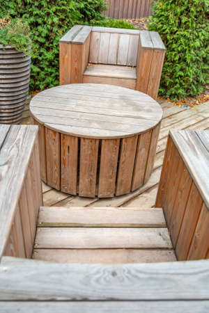 Handmade furniture made of wooden boards. Idea for landscaping the garden and backyard