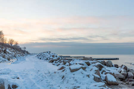 Winter seascape with Baltic Sea waters, horizon and cloudy sky in Kaliningrad region, Russia