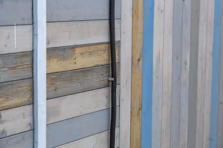Natural wood boards on the outer wall of a country house