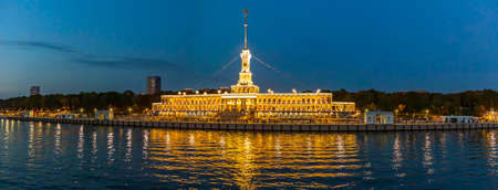 Moscow, Russia - September 12, 2021: Brightly illuminated evening building of the Northern River Station. Built in 1937. Opened after reconstruction in 2020
