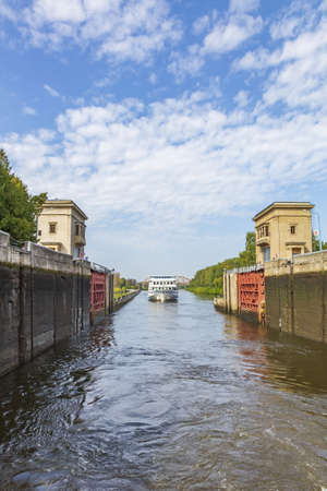Moscow region, Russia - September 10, 2021: An old gateway on the Moscow Canal for adjusting the water level in the riverbed. A suburb of the capital