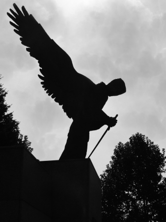 Angel with sword in black and white.