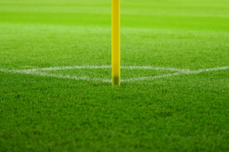 Soccer field corner with yellow flag and line