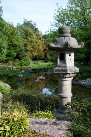 view into japanease garden with small lake and river photo