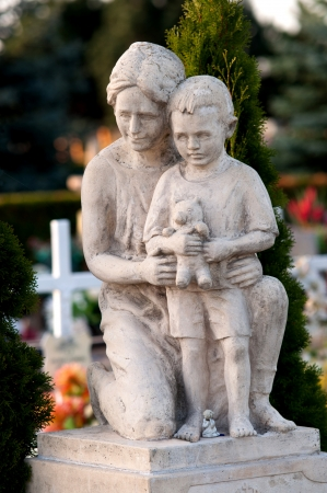 Cementary Statue of mother and son
