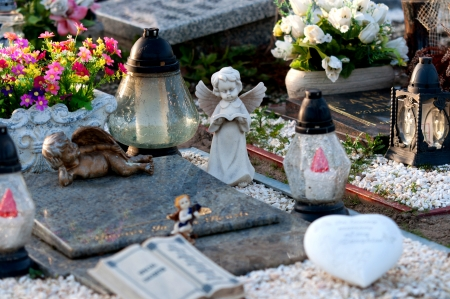 Cementary angel with book on grave Stock Photo
