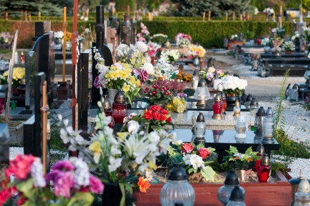 Modern graveyard with candles and flowers