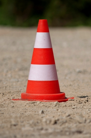 bollard standind on sand road
