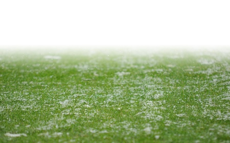 snow on soccer pitch with white gradient Stock Photo