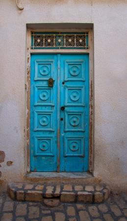 wood carving door: Traditional entrance blue door in Tunisia