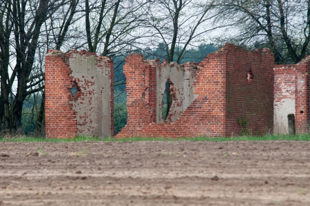 Farmhouse ruin in the field  photo