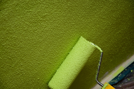 Roller paint with green texture paint  photo