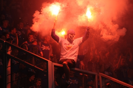 WROCLAW, POLAND - May 06: ultra supporters burn flares during match, Slask Wroclaw vs Lech Poznan on May 06, 2013 in Wroclaw, Poland. Editorial