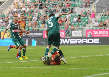 premiership: WROCLAW, POLAND - July 28:T-Mobile Ekstraklasa, Hard attack on Jagielonia goalkeeper Slask Wroclaw vs Jagielionia Bialystok on July 28. 2013 in Wroclaw, Poland. Editorial