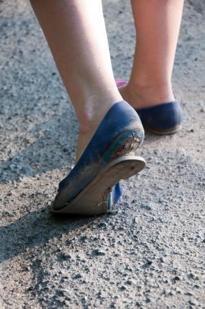 Damaged bottom of shoe close up  Walking Stock Photo