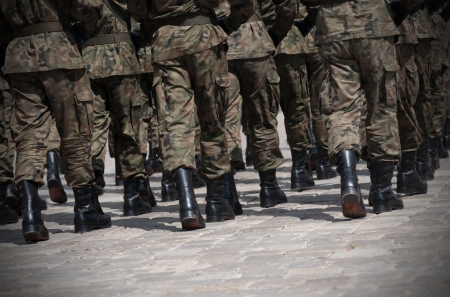 Soldiers march in formation Imagens