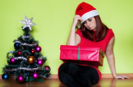 Sad young woman alone in Christmas time