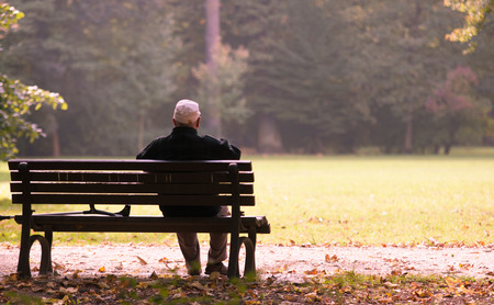 fortunate: Old man sitting on a bench in autumn, autumn of life